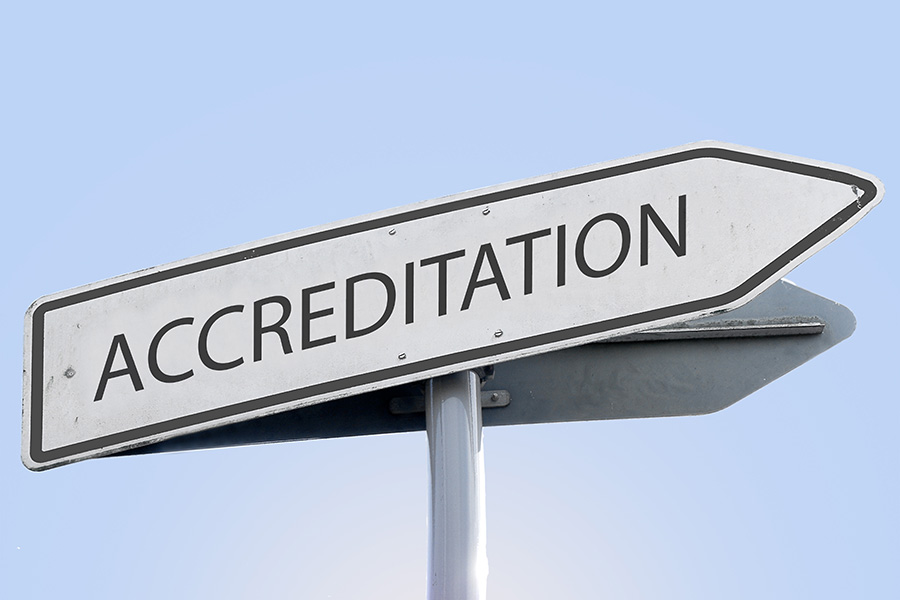 accreditation word on road sign